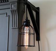 Wall Mount Industrial Cage Light with Cloth Covered Cord and Long Nostalgia Era Bulb